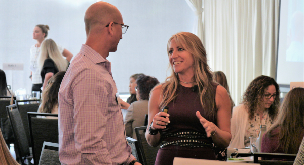PHOTO: Amy Vetter, CPA, CGMA, CITP, talks with OSCPA CFO Kyle Bickhart, CPA, at the June 27 Women, Wealth & Wellness Conference in Columbus.